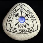 This stone/design is not for sale.  It carries the registered trademark of Colorado School of Mines.  This firestone was created as a personal gift for a CSM Alum and family member.  It is shown here solely to demonstrate production abilities.  We will not produde or sell any trademarked items.